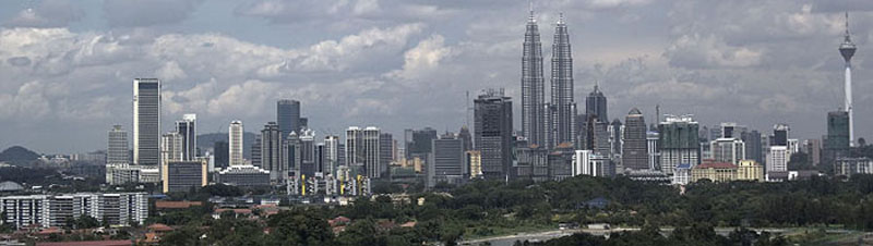 Skyline of Kuala Lumpur, capital of Malaysia. In the centre, the KLCC Twin Towers, at the right the KL tower.